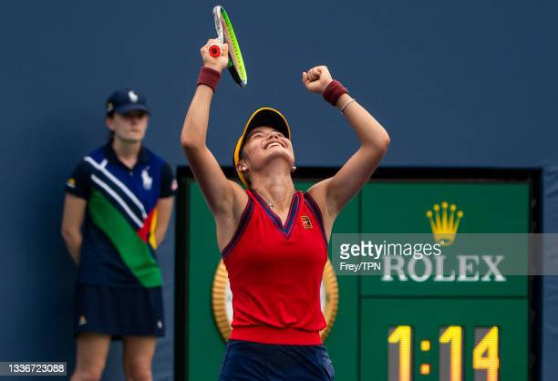 Emma Raducanu of Great Britain celebrates her victory over Mayar Sherif of Egypt in the final round of the women's singles qualifying at the USTA...