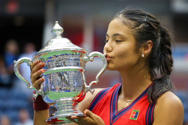 Emma Raducanu of Great Britain celebrates with the championship trophy after defeating Leylah Annie Fernandez of Canada during their Women's Singles...
