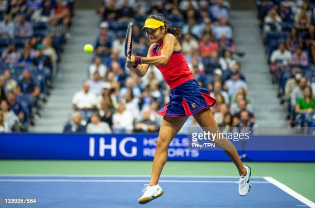 Emma Raducanu of Great Britain hits a backhand against Maria Sakkari of Greece in the semifinals of the women's singles of the US Open at the USTA...