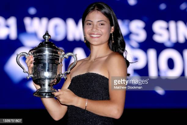 Emma Raducanu of Great Britain poses with the championship trophy after defeating Leylah Annie Fernandez of Canada during their Women's Singles final...