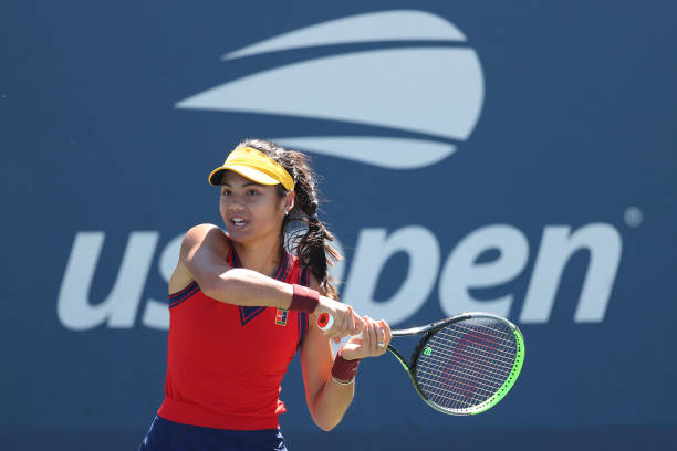 Emma Raducanu of Great Britain returns against Shuai Zhang of China during her Women's Singles second round match on Day Four of the 2021 US Open at...