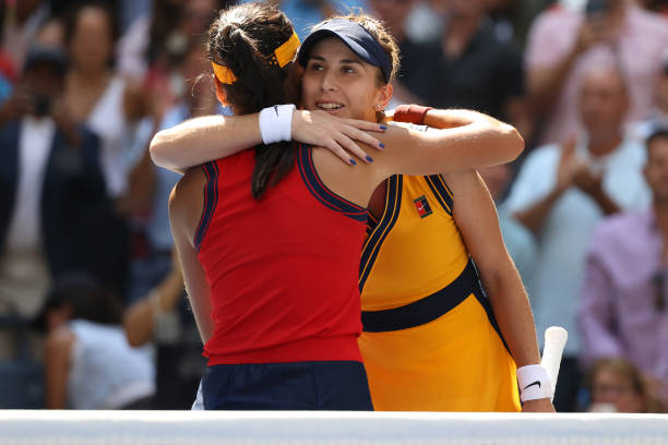 Emma Raducanu of the United Kingdom meets at the net after defeating Belinda Bencic of Switzerland during her Women's Singles quarterfinals match on...