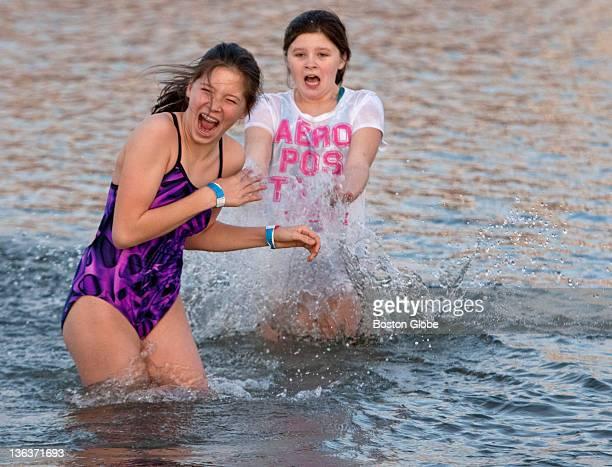 Emma Regan Right Splashing Her Friend Alexis Honzik During The Polar Bear Plunge To Benefit