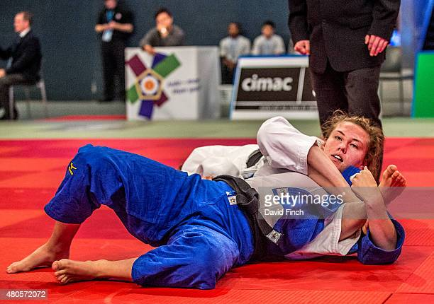 Emma Reid of Great Britain is held with sangakugatame by Gemma Howell for an ippon as Howell progressed to the u70kg gold medal during the 2015...