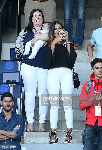 Emma Rhys-Jones, wife of Gareth Bale and their baby daughter Nava Bale celebrate the victory at the final whistle during the UEFA EURO 2016 round of...