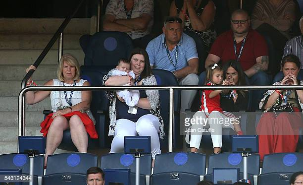 Emma RhysJones wife of Gareth Bale and their daughter Alba Bale cross their fingers while baby Nava Bale and Bale's mother Debbie Bale look on during...