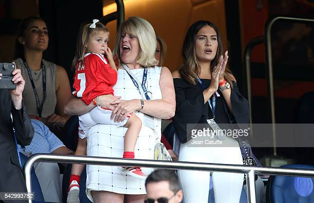Emma Rhys-Jones, wife of Gareth Bale and their daughter Alba Violet Bale attend the UEFA EURO 2016 round of 16 match between Wales and Northern...