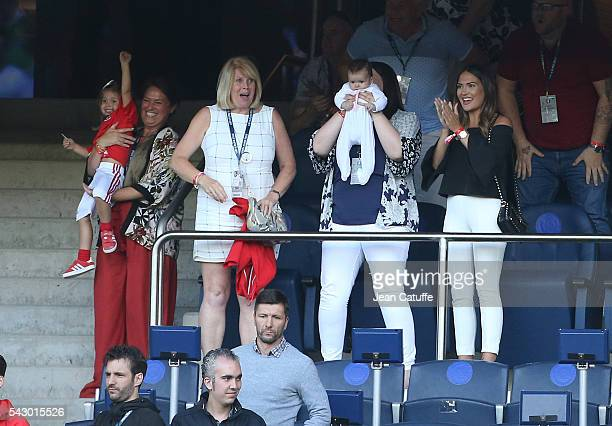 Emma Rhys-Jones, wife of Gareth Bale and their daughters Alba Bale and baby Nava Bale celebrate the victory at the final whistle during the UEFA EURO...