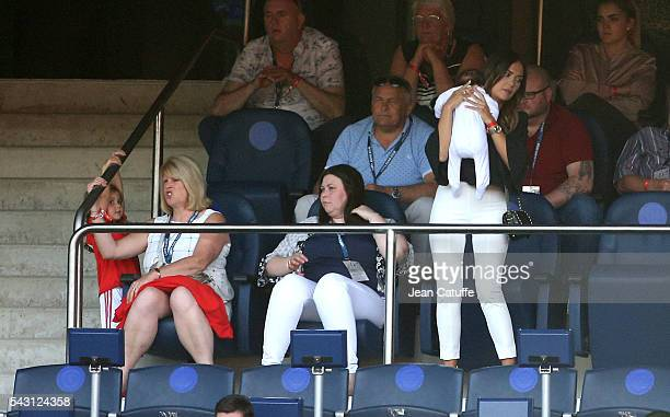 Emma RhysJones wife of Gareth Bale holds baby Nava Bale while Bale's mother Debbie Bale and daughter Alba Bale look on during the UEFA EURO 2016...