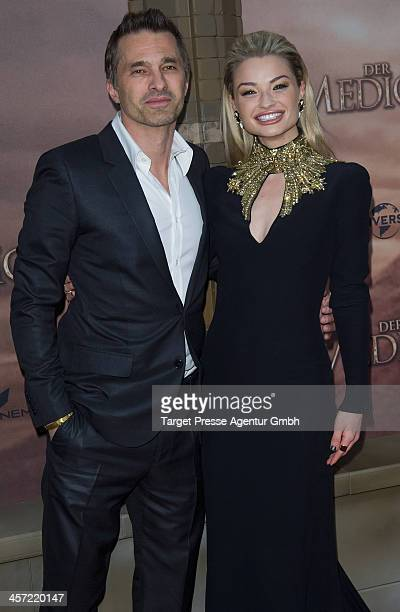 Emma Rigby and Olivier Martinez attend the German premiere of the film 'The Physician' at Zoo Palast on December 16 2013 in Berlin Germany