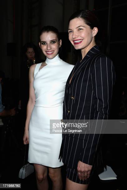 Emma Roberts and Delphine Chaneac attend the Versace show as part of Paris Fashion Week HauteCouture Fall/Winter 20132014 at on June 30 2013 in Paris...