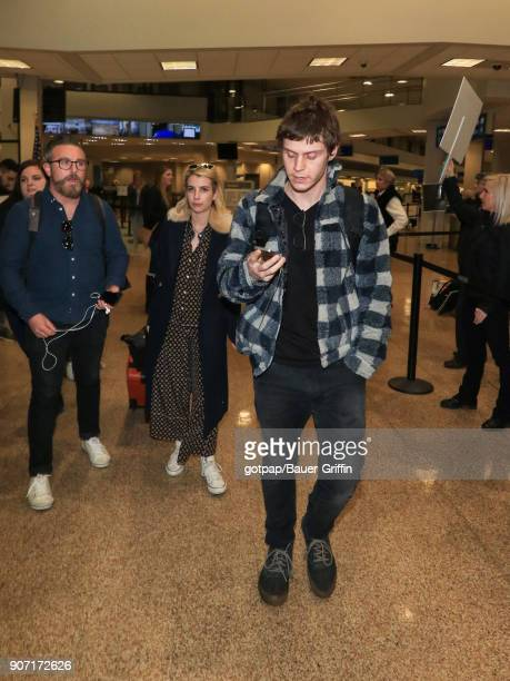 Emma Roberts and Evan Peters are seen at Salt Lake City International Airport on January 18 2018 in Park City Utah