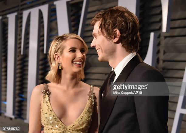Emma Roberts and Evan Peters attend the 2018 Vanity Fair Oscar Party hosted by Radhika Jones at Wallis Annenberg Center for the Performing Arts on...