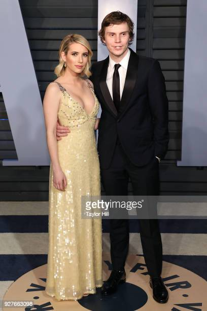 Emma Roberts and Evan Peters attend the 2018 Vanity Fair Oscar Party hosted by Radhika Jones at the Wallis Annenberg Center for the Performing Arts...