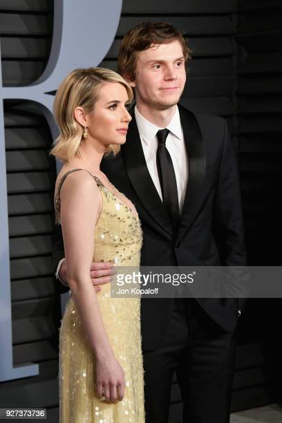 Emma Roberts and Evan Peters attends the 2018 Vanity Fair Oscar Party hosted by Radhika Jones at Wallis Annenberg Center for the Performing Arts on...