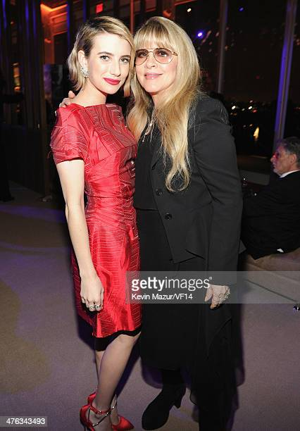 Emma Roberts and Stevie Nicks attend the 2014 Vanity Fair Oscar Party Hosted By Graydon Carter on March 2 2014 in West Hollywood California