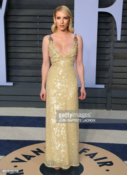 Emma Roberts attends the 2018 Vanity Fair Oscar Party following the 90th Academy Awards at The Wallis Annenberg Center for the Performing Arts in...