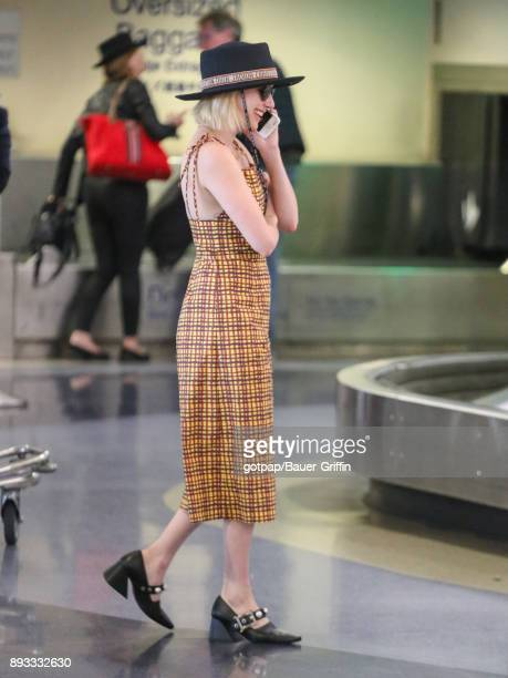 Emma Roberts is seen at Los Angeles International Airport on December 14 2017 in Los Angeles California