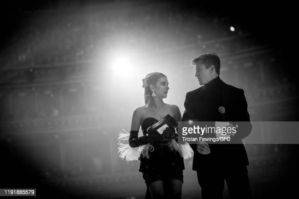 Emma Roberts presents British Designer of the Year – Womenswear to Daniel Lee on stage during The Fashion Awards 2019 held at Royal Albert Hall on...