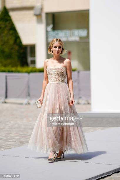 Emma Roberts wears a lace dress outside Dior during Paris Fashion Week Haute Couture Fall Winter 2018/2019 on July 2 2018 in Paris France
