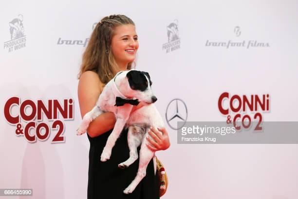 Emma Schweiger and dog Junior attend the 'Conni Co 2 Das Geheimnis des TRex' premiere on April 9 2017 in Berlin Germany