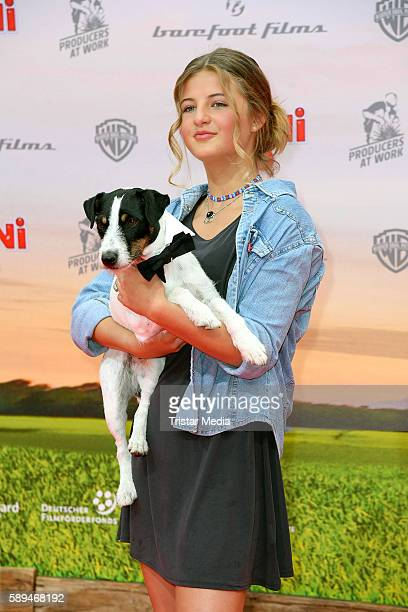 Emma Schweiger and moviedog Frodo attend the 'ConniCo' Berlin Premiere on August 13 2016 in Berlin Germany
