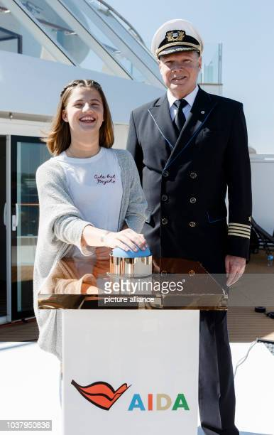Emma Schweiger daughter of Till Schweiger und Detlev Harms captain of the AIDAprima pose on board the ship Hamburg Germany 07 May 2016 The young...