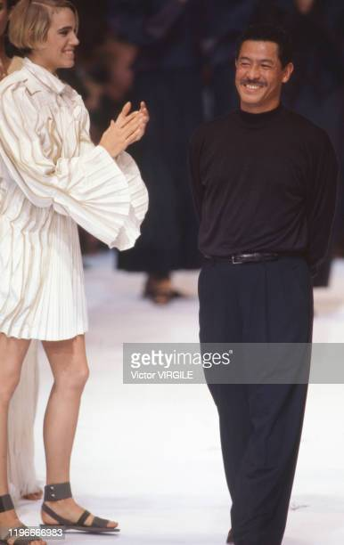 Emma Sjoberg and Fashion designer Issey Miyake walk the runway at the Issey Miyake Ready to Wear Spring/Summer 1991 fashion show during the Paris...
