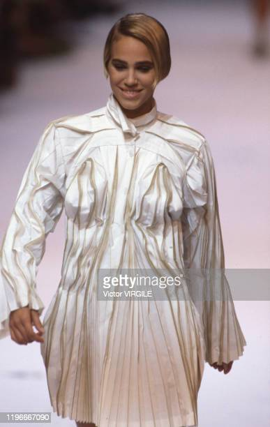 Emma Sjoberg walks the runway at the Issey Miyake Ready to Wear Spring/Summer 1991 fashion show during the Paris Fashion Week in October 1990 in...