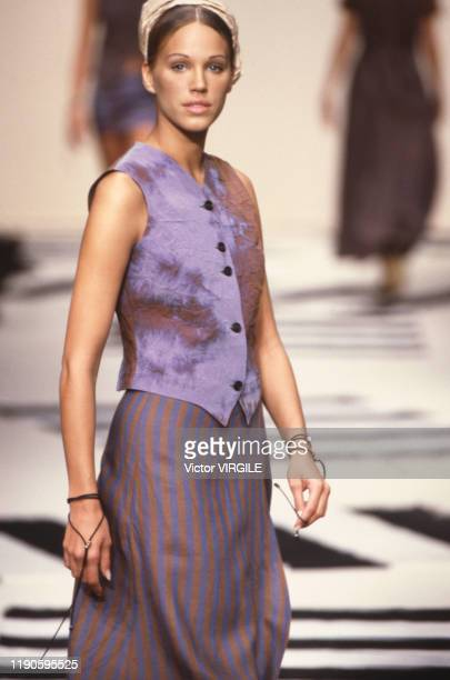 Emma Sjoberg walks the runway at the Marcel Marongiu Ready to Wear Spring/Summer 1993 fashion show during the Paris Fashion Week in October 1992 in...
