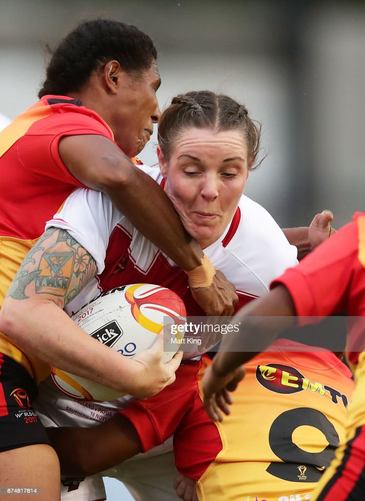 Emma Slowe of England is tackled during the 2017 Women's Rugby League World Cup match between England and Papua New Guinea at Southern Cross Group Stadium on November 16, 2017 in Sydney, Australia.