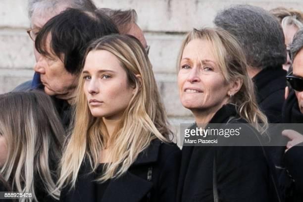 Emma Smet and her mother Estelle Lefebure are seen during Johnny Hallyday's funerals at Eglise De La Madeleine on December 9 2017 in Paris France...