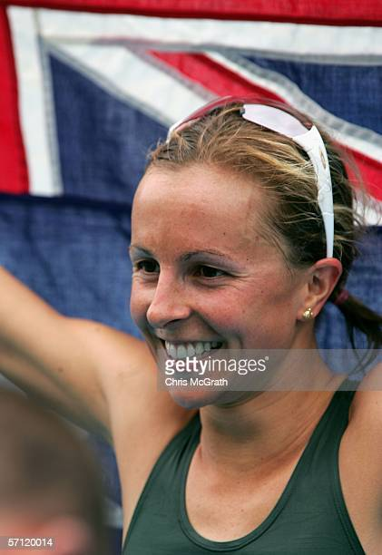 Emma Snowsill of Australia celebrates as she wins gold in the Triathlon Women's Race at the St Kilda Foreshore and Beach Road during day three of the...
