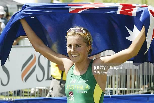 Emma Snowsill of Australia holds up the Australian flag after winning the Women's Elite event at the ITU World Triathlon Championships December 7...