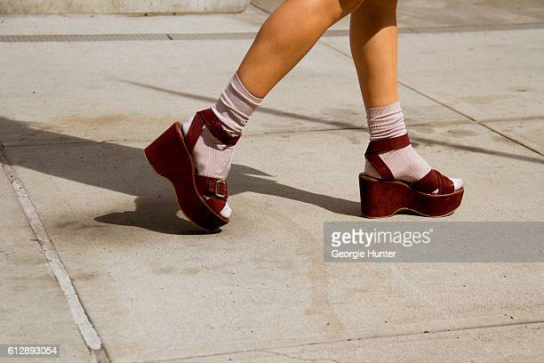 Emma Sousa wearing pastel peach Topshop socks and chunky suede maroon Zara flatform sandals with straps and silver buckles on October 5, 2016 in New...