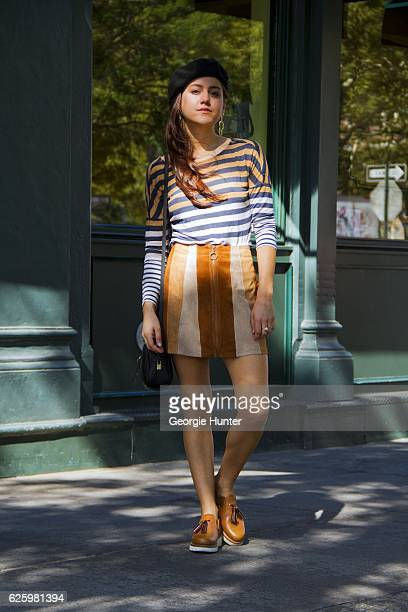 Emma Sousa wearing wide neck blue white and tan horizontal striped long sleeved cotton top by Old Navy tan brown and cream striped high waisted short...
