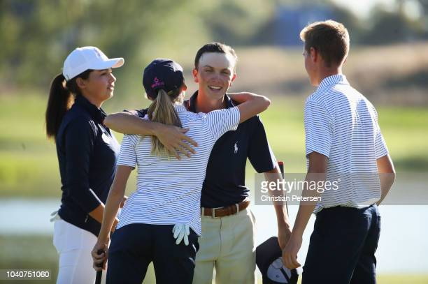 Emma Spitz hugs Cole Ponich of Team USA during the Junior Ryder Cup GolfSixes ahead of the 2018 Ryder Cup at Le Golf National on September 26 2018 in...