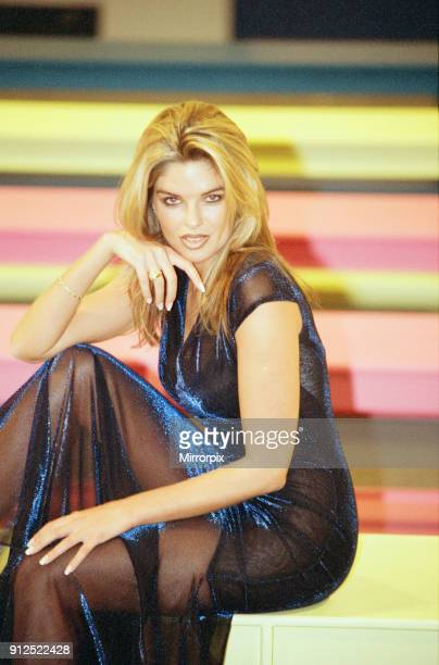 Emma Steadman TV Hostess from The Price Is Right models a Blue Lurex Jersey evening dress made by Dusk at the Premier Women's wear show at the NEC in...