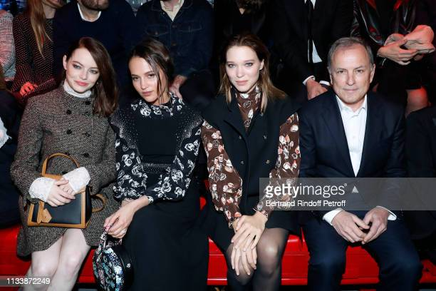 Emma Stone Alicia Vikander Lea Seydoux and CEO of Louis Vuitton Michael Burke attend the Louis Vuitton show as part of the Paris Fashion Week...