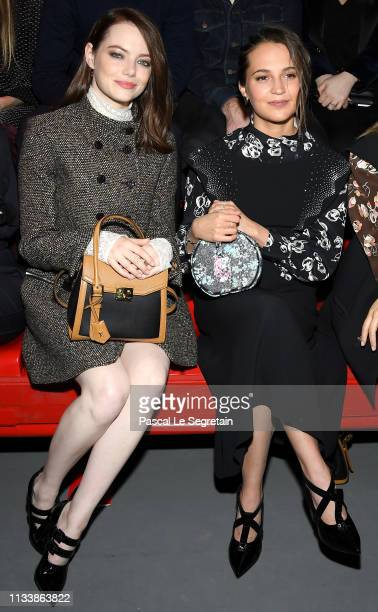 Emma Stone and Alicia Vikander attend the Louis Vuitton show as part of the Paris Fashion Week Womenswear Fall/Winter 2019/2020 on March 05 2019 in...