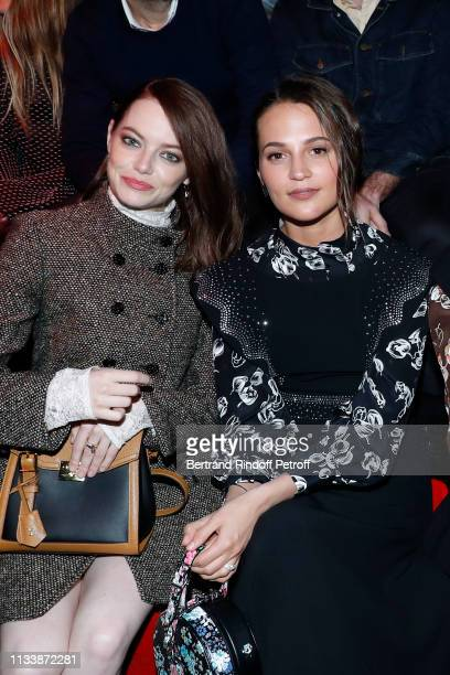 Emma Stone and Alicia Vikander CEO of Louis Vuitton Michael Burke attend the Louis Vuitton show as part of the Paris Fashion Week Womenswear...