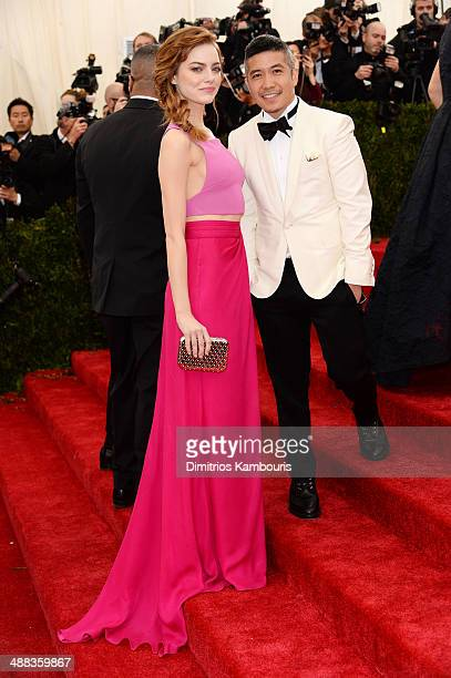 """Emma Stone and designer Thakoon Panichgul attend the """"Charles James: Beyond Fashion"""" Costume Institute Gala at the Metropolitan Museum of Art on May..."""