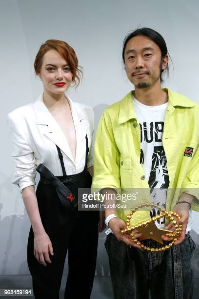 Emma Stone and LVMH Young Designer awarded Masayuki Ino attend the LVMH Prize 2018 Edition at Fondation Louis Vuitton on June 6 2018 in Paris France