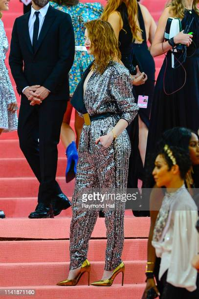 Emma Stone and Nicolas Ghesquire attend The 2019 Met Gala Celebrating Camp Notes on Fashion at Metropolitan Museum of Art at on May 6 2019 in New...