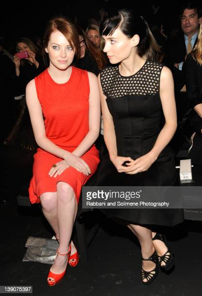 Emma Stone and Rooney Mara attend the Calvin Klein Collection Fall 2012 fashion show during MercedesBenz Fashion Week on February 16 2012 in New York...