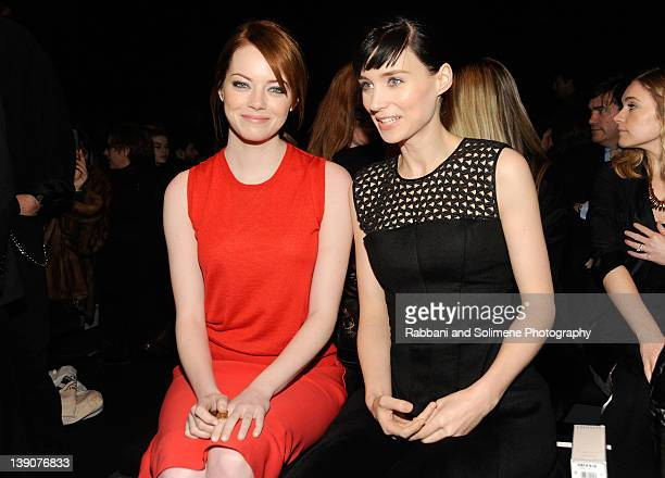 Emma Stone and Rooney Mara attends the Calvin Klein Collection Fall 2012 fashion show during MercedesBenz Fashion Week on February 16 2012 in New...
