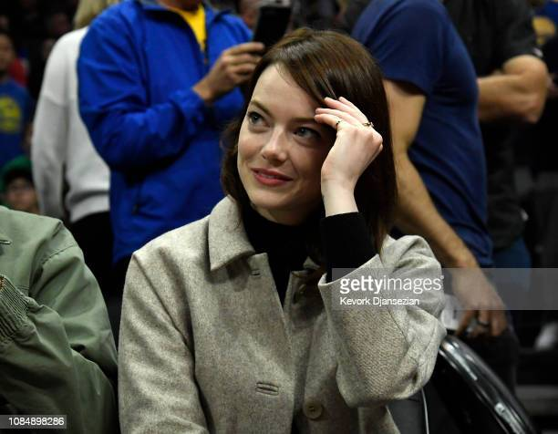 Emma Stone attends the Golden State Warriors and Los Angeles Clippers basketball game at Staples Center on January 18 2019 in Los Angeles California...