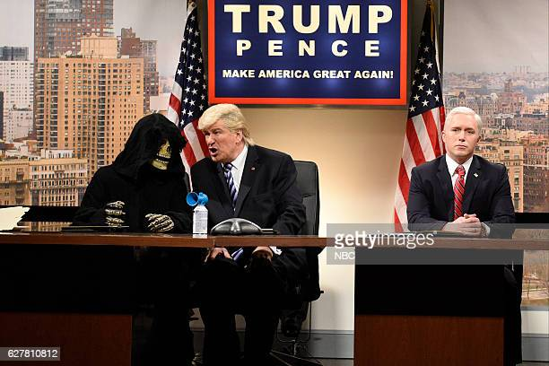LIVE Emma Stone Episode 1712 Pictured Alec Baldwin as Donald Trump and Beck Bennett as Mike Pence during the Classroom Cold Open sketch on December 3...