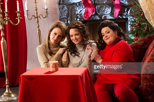 """Emma Stone"""" Episode 1712 -- Pictured: Kate McKinnon, Emma Stone, and Aidy Bryant during """"The Christmas Candle"""" sketch on December 3, 2016 --"""