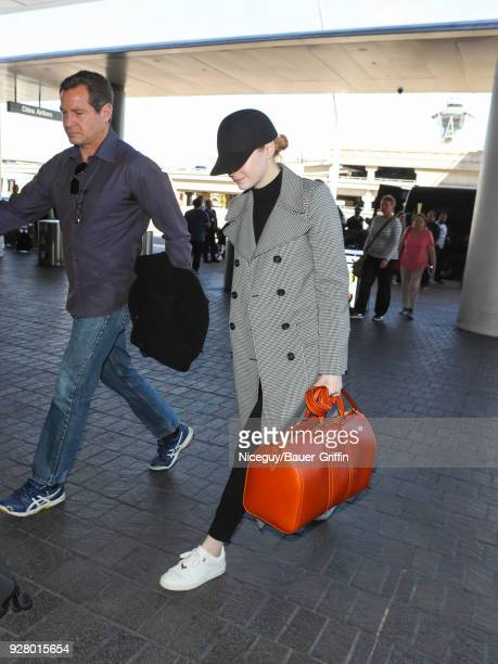 Emma Stone is seen at 'Los Angeles International Airport' on March 05 2018 in Los Angeles California